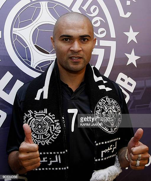Brazil's Afonso Alves poses after signing a threeyear contract with Qatari AlSadd football team in Doha late on September 3 2009 AFP PHOTO/KARIM...