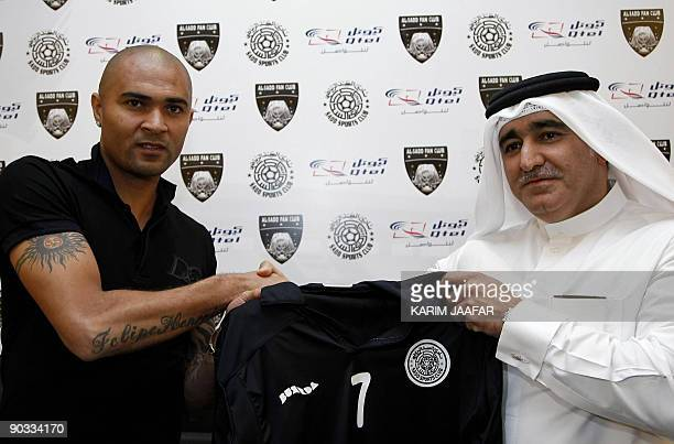 Brazil's Afonso Alves poses with Sheikh Nawaf bin Nasser alThani after signing a threeyear contract with Qatari AlSadd football team in Doha late on...