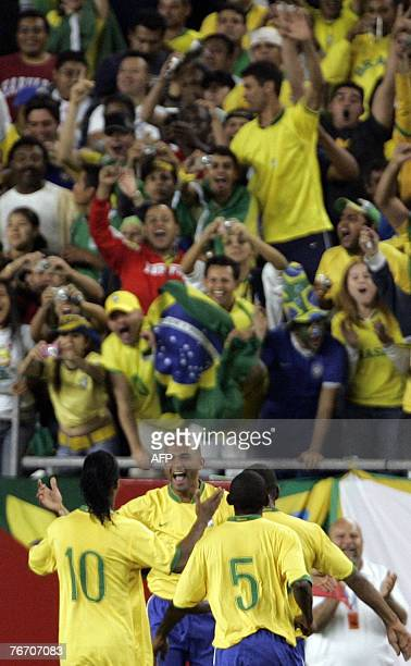 Brazil's Afonso celebrates with teammates and fans after scoring a goal during the second half of a friendly match against Mexico 12 September 2007...