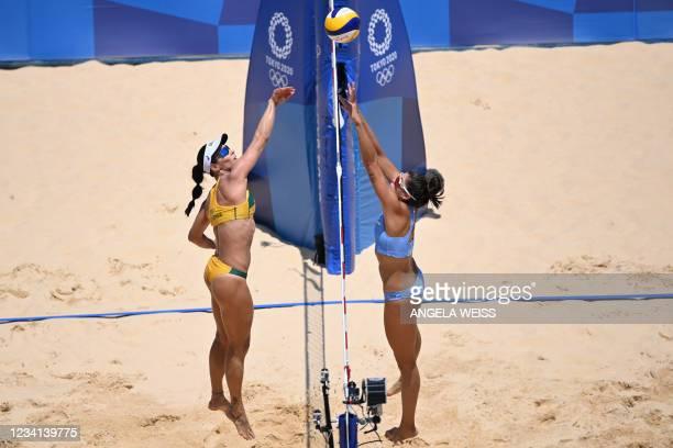 Brazil's Agatha Bednarczuk hits a ball past Argentina's Fernanda Pereyra in their women's preliminary beach volleyball pool C match between Brazil...