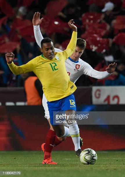 Brazil's Alex Sandro and Czech Republic's Lukas Masopust vie for the ball during the friendly football match between the Czech Republic and Brazil at...