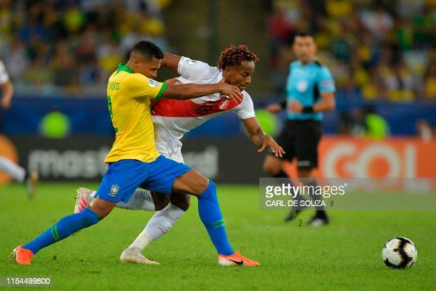 Brazil's Alex Sandro and Peru's Andre Carrillo vie for the ball during their Copa America football tournament final match at Maracana Stadium in Rio...