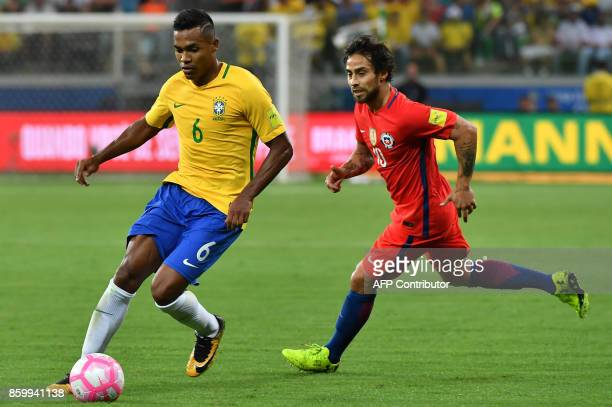 Brazil's Alex Sandro is marked by Chile's Jorge Valdivia during their FIFA 2018 World Cup qualifier football match in Sao Paulo Brazil on October 10...