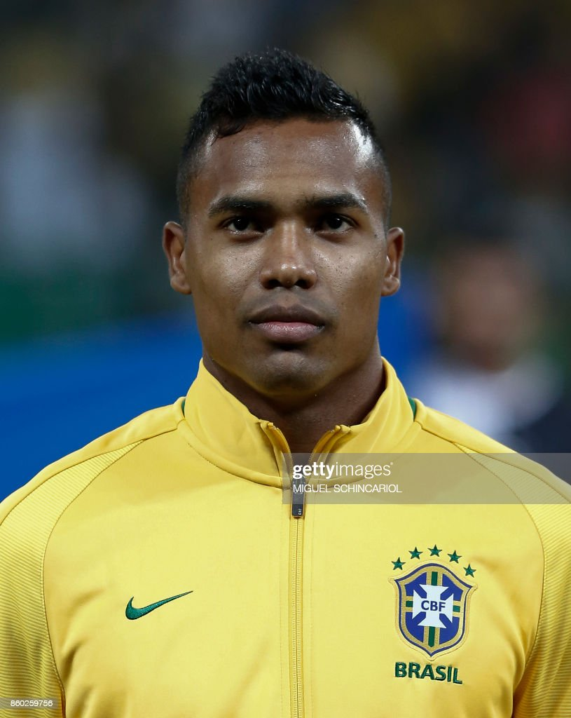 Brazil's Alex Sandro poses before the FIFA 2018 World Cup qualifier football match against Chile in Sao Paulo, Brazil, on October 10, 2017. / AFP PHOTO / Miguel SCHINCARIOL