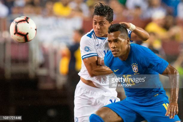 Brazil's Alex Sandro vies for the ball against El Salvador's Oscar Elias Ceren Delgado during an international friendly at FedEx Field in Landover MD...