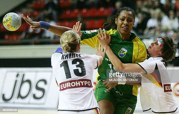 Brazil's Aline dos Santos vies with Nadine Krause and Anne Muler of Germany in a preliminary group C match of XVII Women's World Handball...