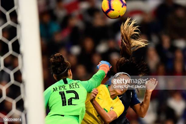 TOPSHOT Brazil's Aline Reis shoots the ball with her fist during their friendly football match France versus Brazil at Allianz Arena Stadium in Nice...