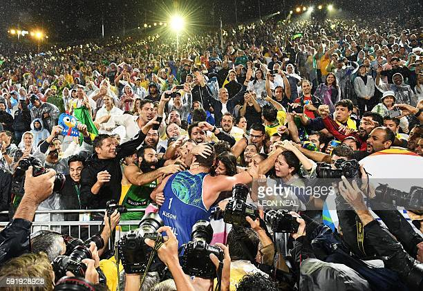 TOPSHOT Brazil's Alison Cerutti celebrates after winning the men's beach volleyball final match between Italy and Brazil at the Beach Volley Arena in...