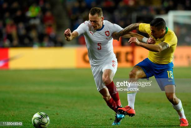 Brazil's Allan and Czech Republic's Vladimir Coufal vie for the ball during the friendly football match between the Czech Republic and Brazil at the...