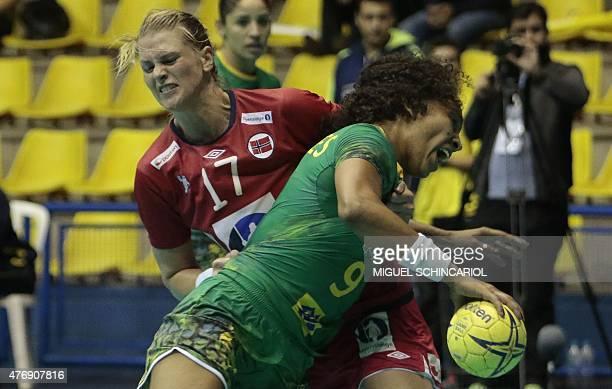 Brazil's Ana Paulo is marked by Norwegian Wibe during the women handball match between world champions and Olympic champions in Sao Bernardo do...