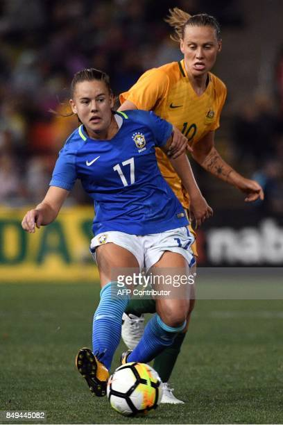 Brazil's Andressa Cavalari Machry fights for ball with Australia's Emily Van Egmond during their women's friendly football match at Newcastle on...