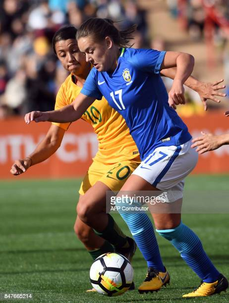Brazil's Andressa Cavalari Machry fights for the ball with Australia's Sam Kerr during a friendly football game in Sydney on September 16 2017 / AFP...