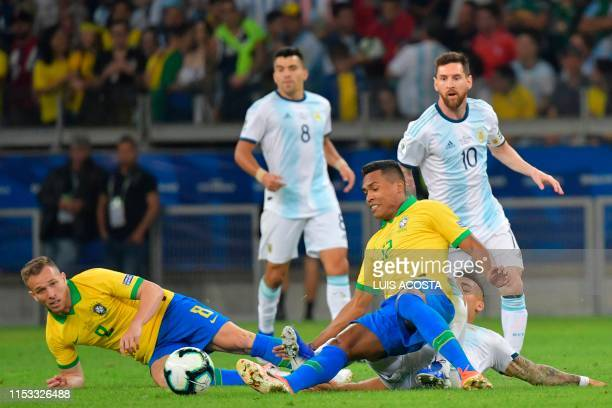 Brazil's Arthur Brazil's Alex Sandro and Argentina's Lautaro Martinez vie for the ball during their Copa America football tournament semifinal match...