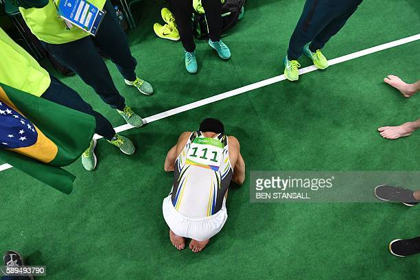 Brazil's Arthur Mariano celebrates after the men's floor event final of the Artistic Gymnastics at the Olympic Arena during the Rio 2016 Olympic...