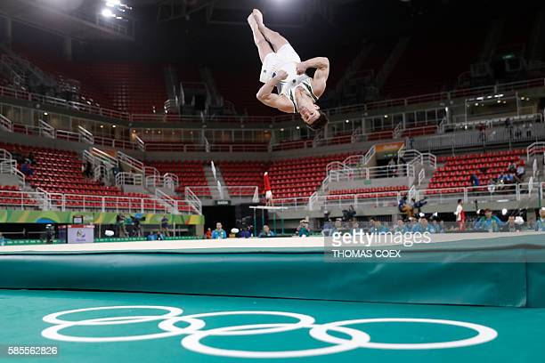 Brazil's Arthur Mariano practices his floor routine at the Olympic Arena the venue of the men's Artistic gymnastics on August 3 2016 ahead of the Rio...