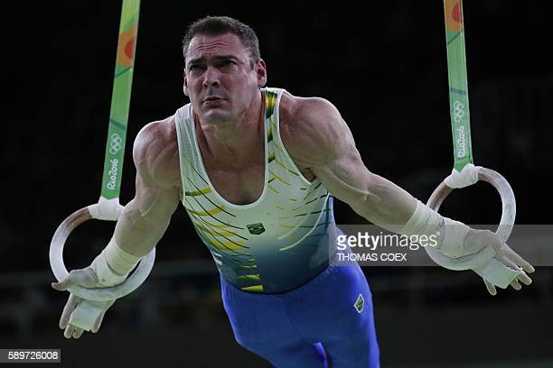 TOPSHOT Brazil's Arthur Zanetti competes in the men's rings event final of the Artistic Gymnastics at the Olympic Arena during the Rio 2016 Olympic...