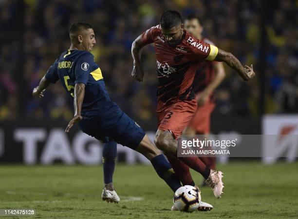 Brazil's Athletico Paranaense Argentine midfielder Luis Gonzalez vies for the ball with Argentina's Boca Juniors midfielder Agustin Almendra during...