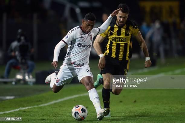 Brazil's Athletico Paranaense Pedro Rocha and Uruguay's Penarol Gary Kagelmacher vie for the ball during their Copa Sudamericana semi-final first leg...