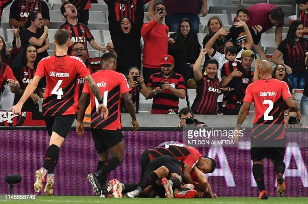 Brazil's Athletico Paranaense players celebrate a goal scored by Marco Rubens against Argentina's River Plate during a Recopa Sudamericana 2019 first...