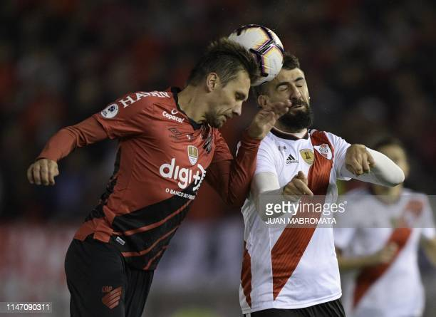 Brazil's Athletico Paranense defender Paulo Andre vies for the ball with Argentina's River Plate forward Lucas Pratto during their Recopa...