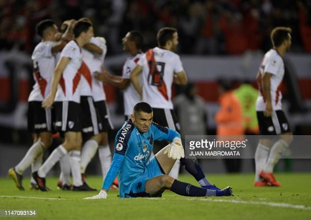 Brazil's Athletico Paranense goalkeeper Santos reacts after Argentina's River Plate forward Lucas Pratto scored the team's second goal during the...
