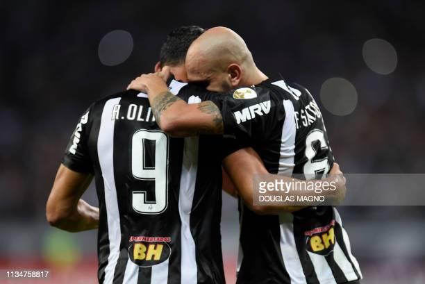 Brazil's Atletico Mineiro Fabio Santos celebrates with teammate Ricardo Oliveira after scoring against Venezuela's Zamora during their 2019 Copa...