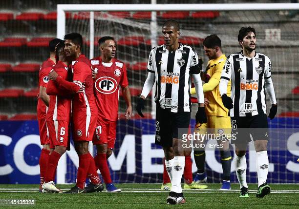 Brazil's Atletico Mineiro footballers leave the field in dejection after being defeated by Chile's Union La Calera in a Copa Sudamericana football...