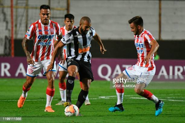 Brazil's Atletico Mineiro Jair vies for the ball with Argentina's Union Claudio Corvalan and Jalil Elias during their Copa Sudamericana football...