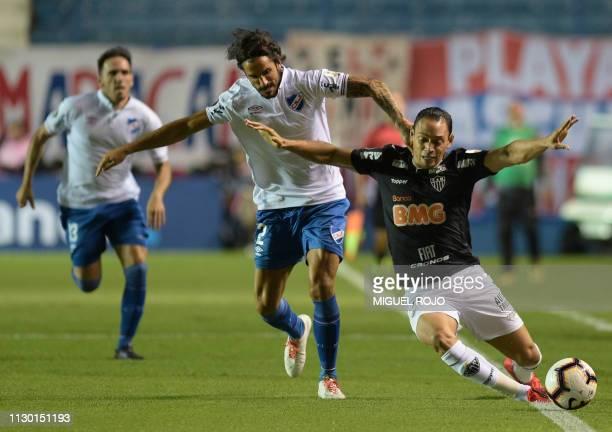 Brazil's Atletico Mineiro player Ricardo Oliveira and Uruguay's Nacional defender Marcos Angeleri vie for the ball during their Copa Libertadores...