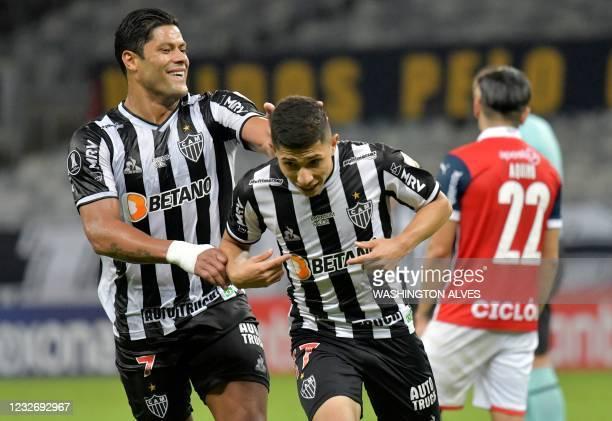 Brazil's Atletico Mineiro Venezuelan Jefferson Savarino celebrates with teammate Hulk after scoring against Paraguay's Cerro Porteno during the Copa...