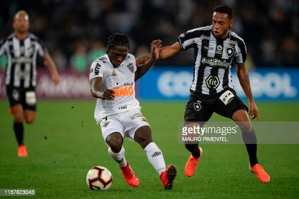 Brazil's Atletico Mineiro Yimmi Chara vies for the ball with Brazil's Botafogo Jean Carlos during their Copa Sudamericana football match at the...