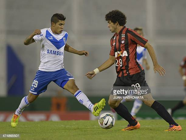 Brazil's Atletico Paranaense forward Bruno Mendes vies for the ball with Argentina's Velez Sarsfield midfielder Lucas Romero during the Copa...