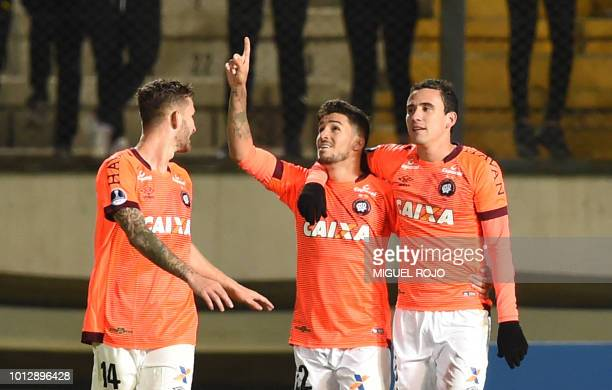 Brazil's Atletico Paranaense forward Marcinho celebrates after scoring theteam's second goal against Uruguay's Penarol during their Copa Sudamericana...