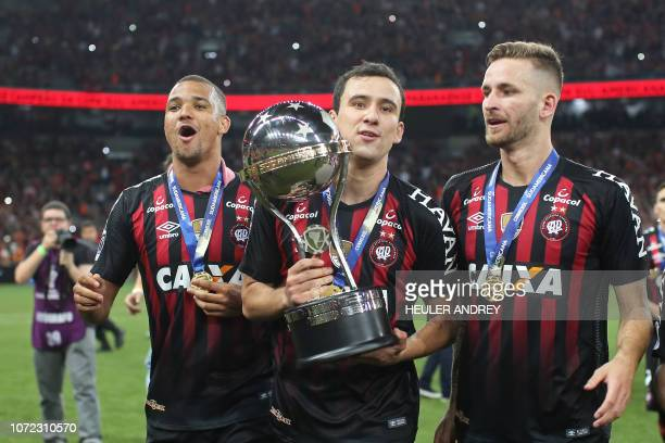 Brazils Atletico Paranaense Jose Ivaldo Pablo and Leo Pereira celebrate with the trophy after winning the 2018 Copa Sudamericana second leg final...