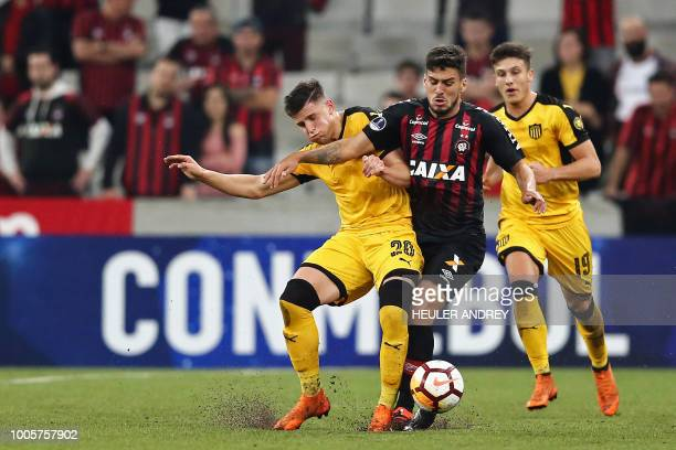 Brazil's Atletico Paranaense Marcinho vies for the ball with Giovanni Gonzalez of Uruguay's Penarol during their 2018 Copa Sudamericana football...