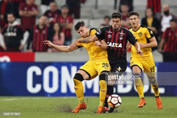 Brazil's Atletico Paranaense Marcinho vies for the ball with Giovanni Gonzalez of Uruguay's Penarol during their 2018 Copa Sudamericana football...