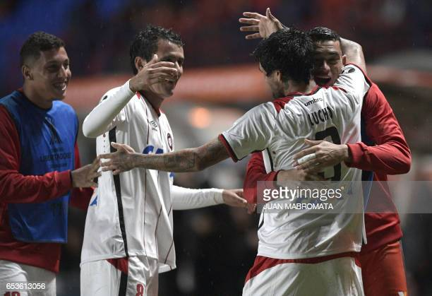 Brazil's Atletico Paranaense midfielder Lucho Gonzalez celebrates with teammates after scoring against Argentina's San Lorenzo during their Copa...