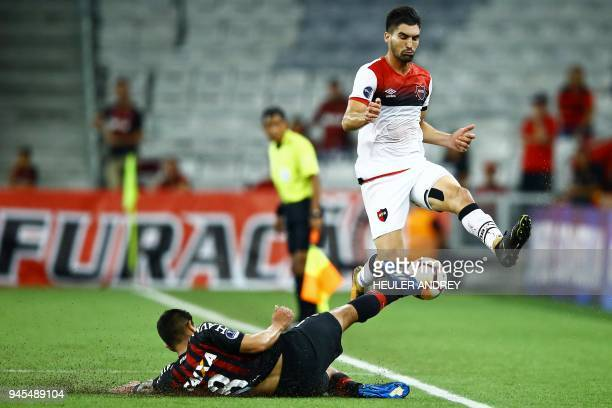 Brazil's Atletico Paranaense player Esteban Pavez vies for the ball with Argentina's Newell's Old Boys player Fernando Evangelista during their Copa...