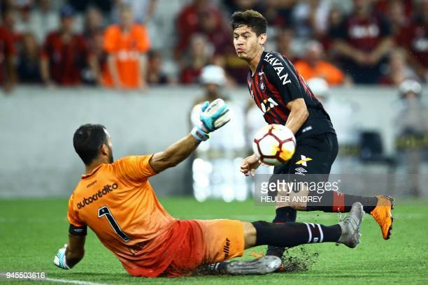 Brazil's Atletico Paranaense player Matheus Rossetto vies for the ball with Argentina's Newell's Old Boys goalie Luciano Pocrnjic during their Copa...