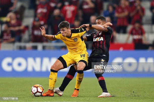 Brazils Atletico Paranaense Renan Lodi vies for the ball with Agustin Canobbio of Uruguay's Penarol during their 2018 Copa Sudamericana football...