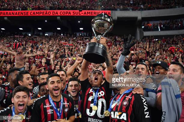 TOPSHOT Brazil's Atletico Paranaense's players celebrate with the trophy after winning over Colombia's Junior during the 2018 Copa Sudamericana...