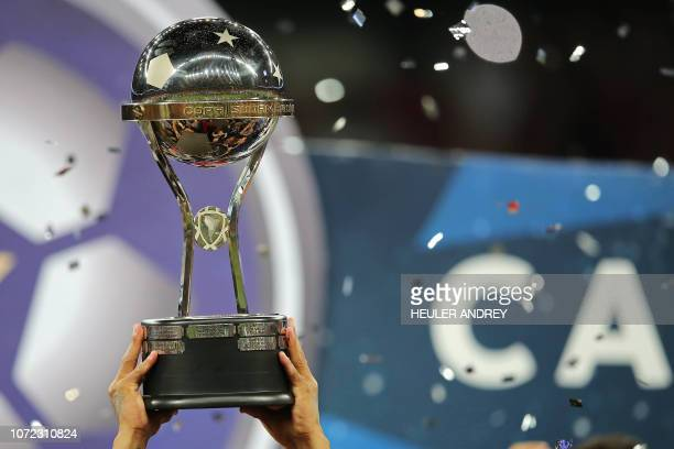 Brazil's Atletico Paranaense's players celebrate with the trophy after winning over Colombia's Junior during the 2018 Copa Sudamericana second leg...