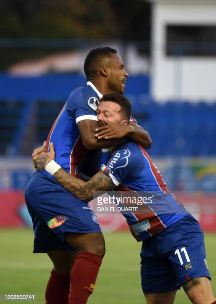 Brazil's Bahia forward Jose Elber Pimentel Da Silva celebrates with teammate forward Rossi after scoring against Paraguay's Nacional during their...