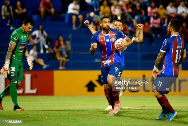 Brazil's Bahia player Gilberto Oliveira celebrates next to teammate Rosicley Pereira after scoring against Paraguay's Nacional during their Copa...