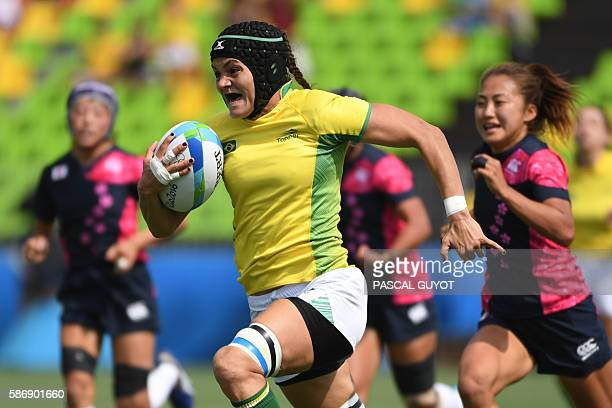 Brazil's Beatriz Muhlbauer runs with the ball in the womens rugby sevens match between Brazil and Japan during the Rio 2016 Olympic Games at Deodoro...