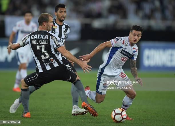 Brazil's Botafogo captain Joel Carli vies for the ball with Paraguay's Nacional Juan Danilo Santacruz during their Copa Sudamericana football match...