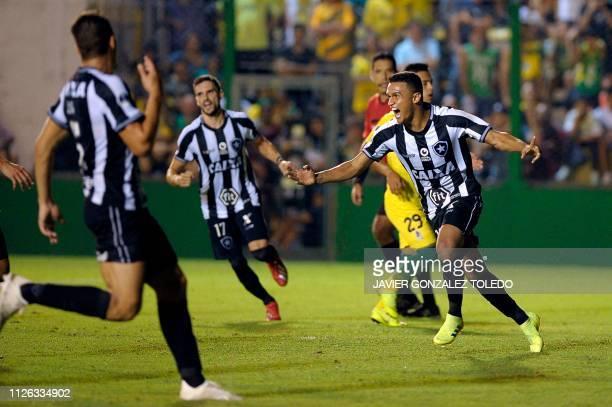 Brazil's Botafogo forward Erik Lima celebrates after scoring during a Copa Sudamericana first round second leg football match against Argentina's...