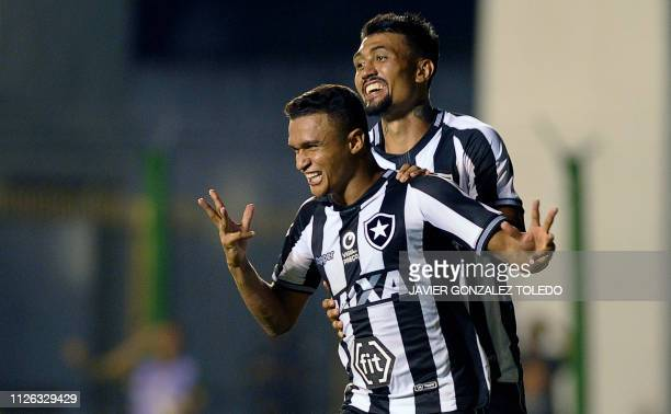 Brazil's Botafogo forward Erik Lima celebrates with a teammate after scoring during a Copa Sudamericana first round second leg football match against...