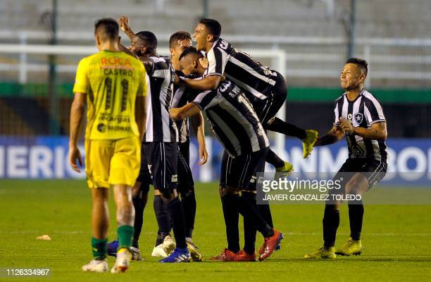 Brazil's Botafogo forward Erik Lima celebrates with teammates after scoring during a Copa Sudamericana first round second leg football match against...