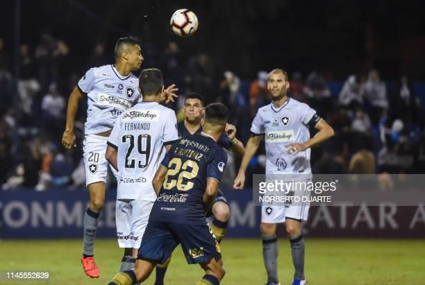 Brazil´s Botafogo player Cicero Santos vies for the ball with Paraguay's Sol de America player Rodrigo Ruiz Diaz during their Copa Sudamericana...